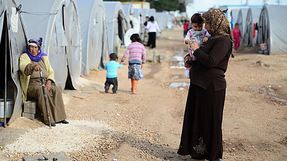 Kvinnor och barn i flyktingläger